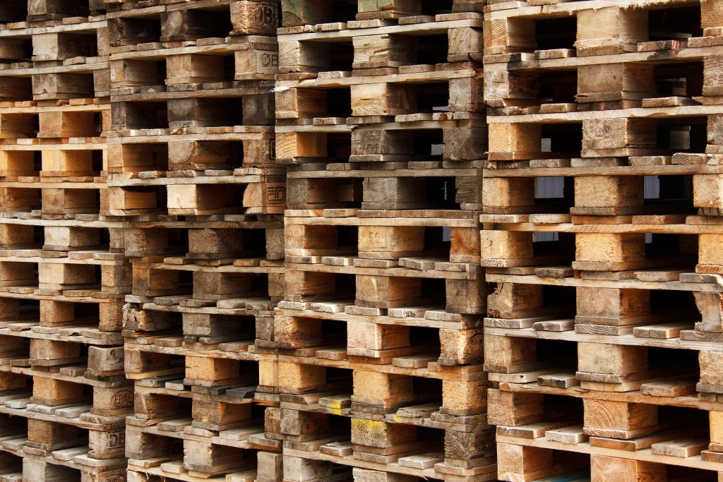 Stacked pallets in a warehouse space.