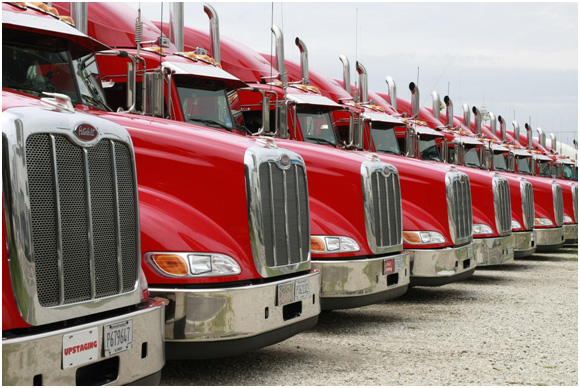 LTL trucking vehicles ready to move products to multiple customers.